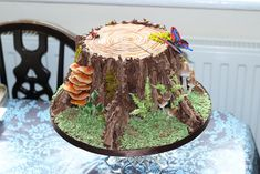 Tree stump woodland cake. 100% edible. Chocolate and marzipan. Great choice for man's birthday cake.