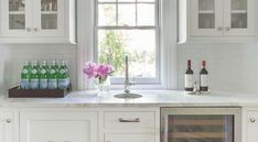 Crisp and Clean | 6 Wet Bar Designs: Steal The Look. Classic white cabinets.