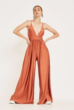19341544e0 Check out UO Gia Plunging Shimmer Jumpsuit from Urban Outfitters Urban  Outfitters