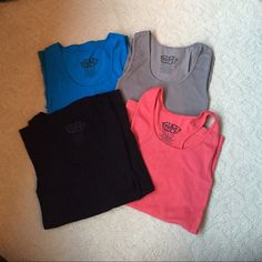 Set of 4 Stretchy Scoop Neck Tank Tops One size. Would best fit a XS - M. All are in great condition. Gray, Blue & Black Tank Top are regular tank tops and the Pink is a racerback tank. Not Lulu. lululemon athletica Tops Tank Tops