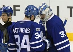 Toronto Maple Leafs' Auston Matthews (34) and goaltender Frederik Anderson celebrate after the Maple Leafs defeated the New Jersey Devils in an NHL hockey game Friday, Jan. 6, 2017, in Newark, N.J. (AP Photo/Bill Kostroun)