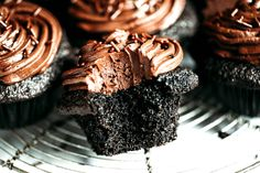 Super easy paleo chocolate cupcakes-moist, but not eggy! These paleo cupcakes have a rich, dark chocolate taste and whipped chocolate frosting!
