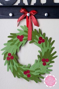 Lots of great wreath ideas are being displayed this year…this is one of my favourites. If you have younger children, why not get them to use paint to create the hand prints? As they may not b…