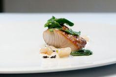 Sake and Harissa-Marinated Cod with Sunchoke Puree, Dehydrated Black Olive, Cippolini Onion, Shishito Pepper, and Crystalline