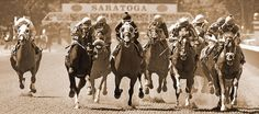 """150 Years of Racing"" This image of horses and jockeys as they leave the backstretch on a seven-furlong race seems timeless.  What makes this piece unique are the distinctive ovals of the Saratoga 150th Commemorative emblems that perfectly frame the starting gate and only appeared for that one year."