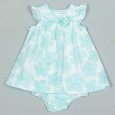 This adorable mint green dress from Little Me is perfect for your newborn girl. A floral pattern and ruffle design finishes this dress.