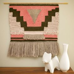 Large weaving done in dark lichen wool roving, bulky pink yarn, light pink alpaca yarn, and oatmeal wool yarn. Measures approximately 24.5