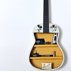 Turn a broken guitar into a piece of art!