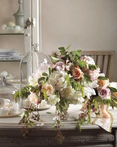 This mix of roses, peonies, and Virginia creeper has an English garden feel to it