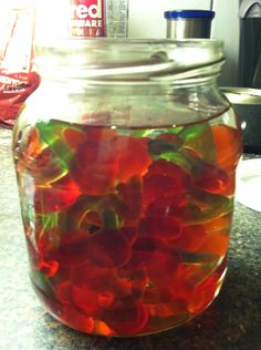 Vodka Gummy Bears. Put bag of gummies in glass container add vodka to cover, cover for 5 days (stir often) serve in shot glasses. For sweeter taste add frozen juice concentrate after 5 days, then wait 4 more days.