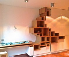 Modern Storage Unit Features Stylized Shelving Mimicking a Crack in the Earth's Surface - My Modern Met