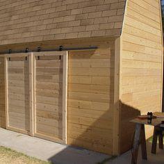 Make sliding barn doors using skateboard wheels.