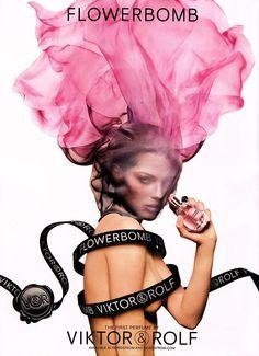 FLOWERBOMB (2008) (Viktor & Rolf): grenade shaped bottle, flower/explosion-like fabric around   model Isabeli Fontana's head