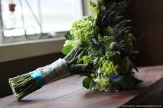 """For Liz's bouquet we used lavender, green celosia, green hydrangea, bupluerum, blue thistle and peacock feather accents."""