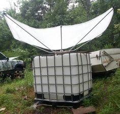 Collect water from FOG. Customer in Arkansas first to put an RainSaucer on a 270 gallon IBC Tote. This setup is uphill from the home. She plans on feeding it to a small water tower near the garden for easy irrigation. Water Collection System, Rain Collection, Arkansas, Water Catchment, Rain Catchment System, Rainwater Harvesting System, Water From Air, Water Storage, Water Tower