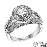 Split Shank Diamond Encrusted Round Halo Engagement Ring available at Wheat Jewelers #halo #vintage
