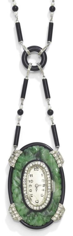 AN ART DECO JADE, DIAMOND, ONYX AND PEARL PENDANT WATCH, CIRCA 1925. The necklace composed of alternately arranged onyx cylinders, onyx spheres and Oriental pearls, connected by an onyx ring with diamond-set connectors, suspending an oval carved jade pendant centring a watch framed by onyx, and diamond-set prongs, mounted in platinum. Pendant 4.4 x 2.9cm, necklace length 50 cm. #ArtDeco #PendantWatch