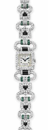 Art Deco diamond, onyx, and emerald watch by Van Cleef & Arpels