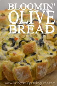 This insanely delicious Bloomin' Olive Bread is pretty much just a party for your mouth. Filled with gooey melted cheese, fresh green onions, and flavor-packed olives, it is the quick & easy side dish guaranteed to steal the show! Great Appetizers, Appetizer Recipes, Bread Recipes, Cooking Recipes, Cheese Recipes, Grilling Recipes, Pan Relleno, My Burger, Tapas