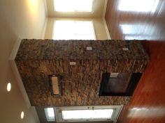 Beautiful double sided fireplace done in a natural stone. avstile.com