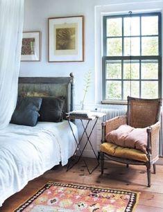 Leather chair, antique rug, asymmetrical photo wall