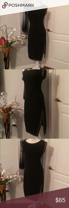 MICHAEL KORS dress with sexy leg slit MICHAEL KORS sleeveless black dress. Size medium. Gold metal detail on sleeves and hem. Leg slit, gorgeous and sexy. MICHAEL Michael Kors Dresses Midi