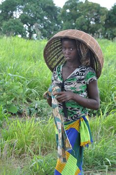 Girl with Basket. A member of the Morrumbala community in Zambezia province, Mozambique.