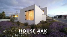 A home for the family, by the family. House 4AK  by SwanSilva was designed by architects Johan Swanepoel and Ann-Mari Da Silva in 2017, with help from concept architect Marcel Swanepoel. Built around a central courtyard, the house was completed in 2019 and now stands proudly in Kleinmond, Western Cape. It boasts views of both the mountains and ocean from almost every room in the house with a separate apartment above the large multi-functional garage, plus an extended roof garden terrace to…