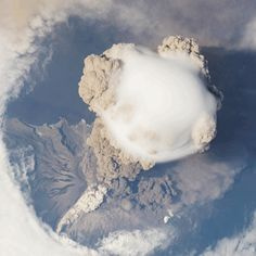 Volcano erupting from space [gif] via @binx