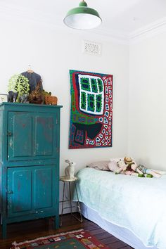 Freya and Edward's room – painting by Weaver Jack at Short St. Gallery, Broome.  Photo - Rachel Kara, Production – Lucy Feagins / The Design Files.