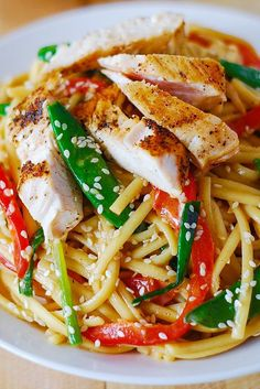 Asian chicken salad with noodles and peanut sauce - Introducing my new favorite Asian chicken salad: crunchy veggies, soft noodles, grilled or cooked chicken – all mixed in with the delicious, creamy, deeply