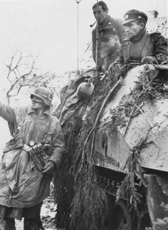 Soldiers of the 116th Panzer division in an armored personnel carrier Sd.Kfz.250 / 5 during the Ardennes offensive.