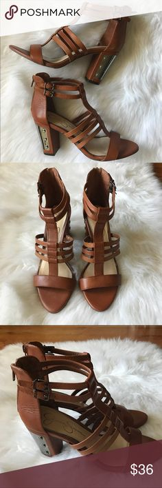 Jessica Simpson Cognac Sandals NWT New with tags Jessica Simpson cognac sandals with silver details. 3.5 inch stacked heel. Last photo shows inside left shoe leather rubbing. Comfortable and true to size. Jessica Simpson Shoes Heels
