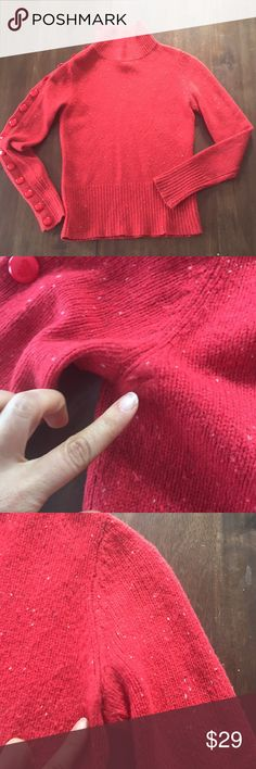 """Anthro MOTH Red Speckled Turtleneck w/Buttons XS Anthro MOTH Red Speckled Turtleneck w/Buttons Women's Sz XS. In good preloved condition. There is some pilling (Lambswool/nylon/Cashmere) and wear to the sweater as seen in the photos, still a lot of life left in it. Has cute buttons along the neck and right sleeve. Length-21.75"""", pit to pit-16.25"""", sleeve length-24.25"""". Fitted. Anthropologie Sweaters Cowl & Turtlenecks"""