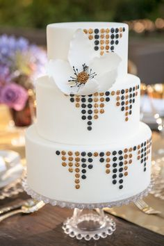 Glamorous Gold and Black Art Deco Wedding Cake | Allyson Wiley - See the whole wedding: http://heyweddinglady.com/vintage-hollywood-glam-in-...