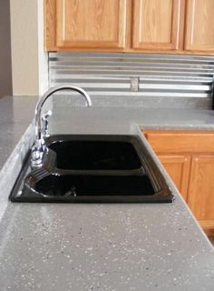 Paint countertops with epoxy concrete paint used for garage floors! Genius!