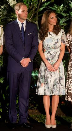 """September 12, 2012: Prince William and Kate Middleton attend a reception at Eden Hall in Singapore. Kate is wearing a white and painted floral dress from Erdem's Spring 2012, with the addition of sleeves. The heels are Kate's trusty L.K. Bennett suede """"Sledge"""" pumps in off-white."""