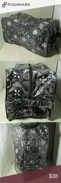 """THIRTY ONE *huge* Black Zippered Cosmetic Bag Brand: Thirty One  Item: *An absolutely HUGE zippered top and halfway down each side make-up, cosmetics, hair products or even a shoes bag. *Entire Bag Covered in Protective Plastic *One handle on one end that runs the entire depth. *Interior is completely plastic - many black marks as shown in pic   Color: Black, White Design that has lavender in it.  Measurements: 13.5""""w x 8""""h x 7""""d  Condition: Other than interior black marks, very, very good…"""
