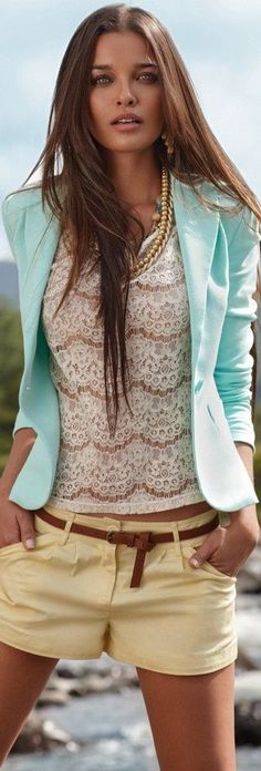 Shop this look on Lookastic:  http://lookastic.com/women/looks/earrings-necklace-blazer-crew-neck-t-shirt-belt-shorts/8785  — Gold Earrings  — Gold Necklace  — Light Blue Blazer  — White Lace Crew-neck T-shirt  — Brown Leather Belt  — Yellow Shorts