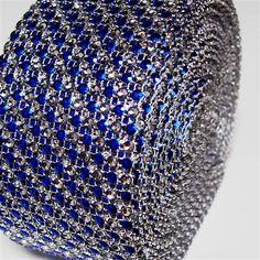 Adorn large size favor boxes, wrap around table centerpieces, gift boxes for a glistening effect. Large size for larger surface areas. Shines and glistens in light. This can be used to decorate large