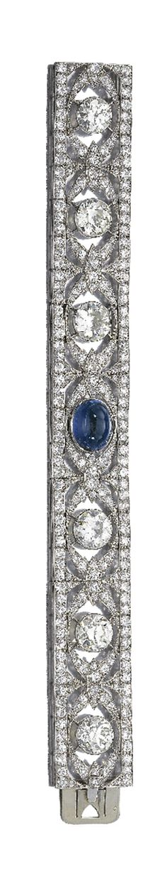 Sapphire and diamond bracelet, circa 1925. The articulated ribbon set throughout with circular and single cut diamonds, enhanced at the center with a sapphire cut en cabochon. French assay marks.