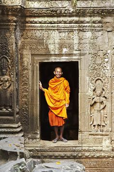 Chhum Sdeong stands at a Ta Prohm temple entrance. Image by Mark Read / Lonely Planet Traveller.