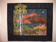 This is a fall scene landscape quilt I made using batik fabrics and I used novelty prints for the birds, cows and barn.