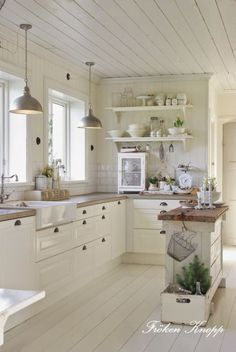 Rustic country white kitchen with Narrow island and lots of drawers, open shelves, pendant lighting