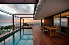 "THE V HOUSE, SPAIN  Barcelona based architecture firm Magma have just completed The V House: a beautiful new residence on the bluffs of Costa Brava, a tiny coastal region in northeast Spain. The picturesque home is fastened to the hill and described by the architects that it is designed ""with the intensity of a single-family house, but can be divided into three independent homes."" The team goes on to explain that ""The site, which is very steep,"" therefore they built the home on a large stone…"