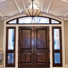 stained transom and side lights with painted trim