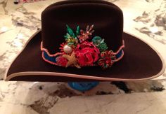 """""""Arial"""" is headed out to Florida!!!! I really love how The Rowdy Rose vintage embellished cowboy hat has turned out. We did a turquoise lace band lined with coral. A colorful mixture of enamel vintage jewels completes this one of a kind piece."""