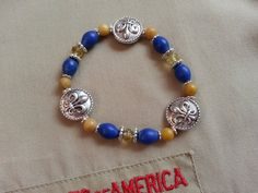 CUB SCOUT Colors Ladies' Stretchy BRACELET in Blue and Gold with Pewter Fleur de Lis Beads (#11205) on Etsy, $12.50