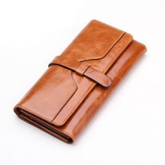 100% oil waxing cowhide wallet for women Long designer drew-string. Item Type: Walletis_customized: YesClosure Type: HaspItem Width: 2Item Height: 19 cmGender: WomenPattern Type: SolidLining Material: Genuine LeatherStyle: FashionMain Material: Genuine LeatherWallet Length: LongItem Length: 9.7 cmItem Weight: 0.18Material Composition: oil wax Head layer cowhideWallets: Standard WalletsModel Number: 32Brand Name: None