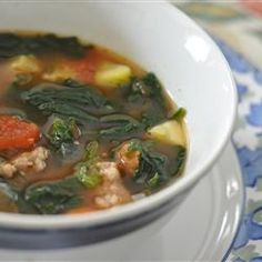 Italian Sausage Soup - 1600+ reviews on all recipes - Original recipe makes 6 servingsChange Servings  1 pound Italian sausage  1 clove garlic, minced  2 (14 ounce) cans beef broth  1 (14.5 ounce) can Italian-style stewed tomatoes  1 cup sliced carrots  1 (14.5 ounce) can great Northern beans, undrained  2 small zucchini, cubed  2 cups spinach - packed, rinsed and torn  1/4 teaspoon ground black pepper  1/4 teaspoon salt